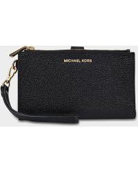 MICHAEL Michael Kors - Double Zip Wristlet In Black Grained Calfskin - Lyst