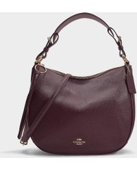 e0bbfb87c302 COACH - Polished Pebble Leather Sutton Hobo Bag In Burgundy Calfskin - Lyst