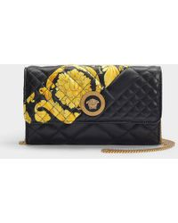 Versace - Quilted Print Clutch Bag - Lyst