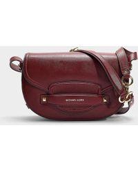 5c2cd6d09 Lyst - Michael Michael Kors Cary Medium Saddle Bag In Brown Calfskin ...