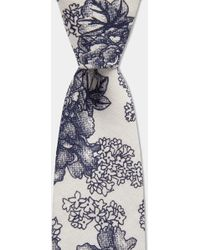 Moss London White With Large Navy Rose Print Tie
