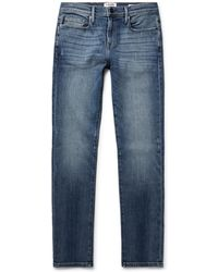 FRAME - L'homme Skinny-fit Distressed Stretch-denim Jeans - Lyst