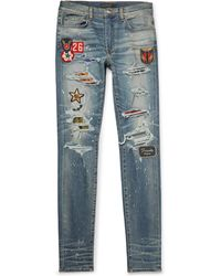 Amiri - Skinny-fit Appliquéd Panelled Distressed Stretch-denim Jeans - Lyst