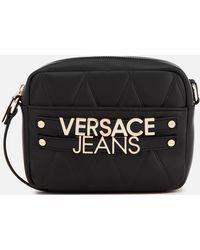 f6d4f1a3b3d5 Lyst - Versace Jeans Embossed Logo Saddle Crossbody Bag in Black