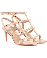 0e87091130b6 Valentino Rockstud Patent Leather Sandals in Pink - Lyst
