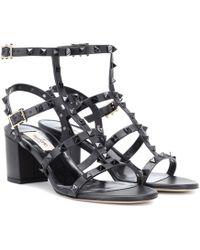 ba626362fd2 Lyst - Valentino Rockstud Gladiator Mid Chunky Heel Sandal Black in ...