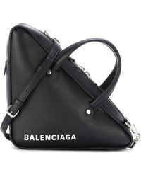 1b177e966c46 Lyst - Saint Laurent Classic Duffle 12 Leather Bag in Natural
