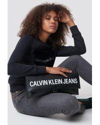 Calvin Klein - Sculpted Lg Ew Clutch Black - Lyst