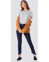 NA-KD - Slanting Hem Jeans - Lyst