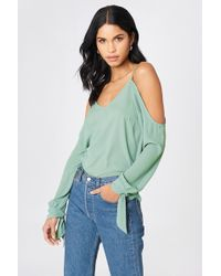 NA-KD - Cold Shoulder Knot Sleeve Top Duck Green - Lyst