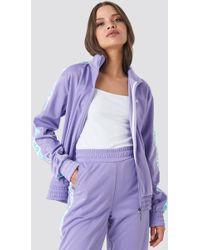 84278343d552a Fila - Women Strap Track Jacket Purple - Lyst