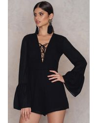 NA-KD - Lacing Front Wide Sleeve Playsuit - Lyst