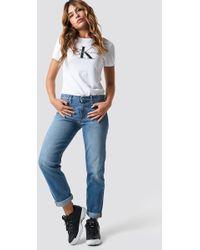 Calvin Klein - Mid Rise Boy West Jeans Auckland Blue - Lyst