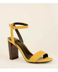 635cbaa11c2 New Look Wide Fit Mustard Suedette Ring Cross Strap Sandals in ...