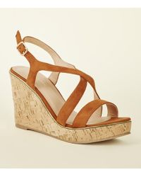 569b9a9acb17 New Look - Tan Suedette Metal Edge Cross Strap Wedges - Lyst