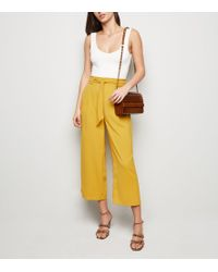 48ea005861 New Look Yellow Stripe Tie Waist Cropped Trousers in Yellow - Lyst