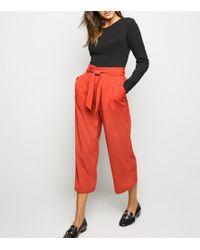 c9f2238953e00 River Island Plus Orange Print Wide Leg Trousers in Orange - Lyst