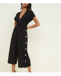 New Look - Black Popper Side Ribbed Wrap Jumpsuit - Lyst