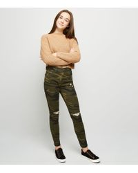 New Look - Girls Green Camo Ripped Skinny Jeans - Lyst