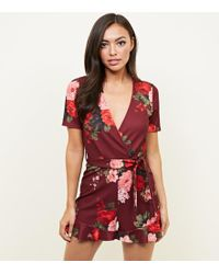 a4d76d60d1 New Look Petite Red Floral Wrap Front Playsuit in Red - Lyst