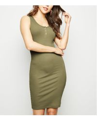 d689966038 New Look - Khaki Ribbed Popper Front Bodycon Dress - Lyst