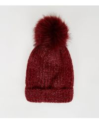 b1345ed42a1 New Look - Burgundy Ribbed Faux Fur Bobble Hat - Lyst