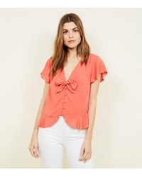 New Look - Coral Bow Front Peplum Blouse - Lyst