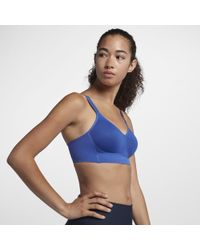 1adc42b93bffd Lyst - Nike Indy Shine Women s Light Support Sports Bra in Yellow