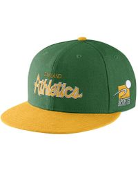 huge discount a7261 c001e ... greece nike pro sport specialties mlb as adjustable hat green lyst  012f9 499c8