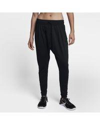 Nike - Pantaloni da training a vita media Dri-FIT Lux Flow - Lyst