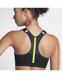 e5f05952c8 Lyst - Nike Fierce Zonal Support Women s Sports Bra in Purple