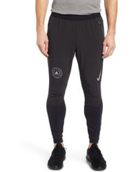 4b321c119190 Nike Swift Panelled Dri-fit Sweatpants in Black for Men - Lyst