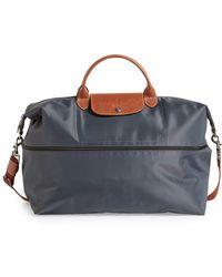 5a285560e Longchamp Le Pliage Monogrammed Expandable Travel Bag in Black - Lyst