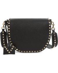 Valentino - Rockstud Leather Saddle Bag - Lyst