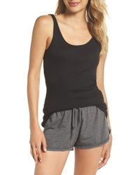 84e2801b4cd28d Lyst - Chaser Ruffle T-back Shirttail Cami in Black