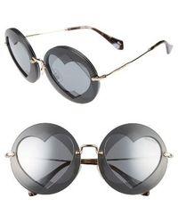 b693db333c4 miu miu round sunglasses