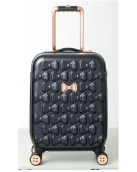 Ted Baker - Small Beau 22-inch Bow Embossed Four-wheel Trolley Suitcase - Lyst