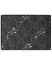 1fd2bf1a36aa35 Gucci Tiger Embossed Wallet in Black for Men - Lyst