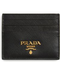 e58c834ee657 Prada Saffiano Print Passport Holder in Black - Lyst