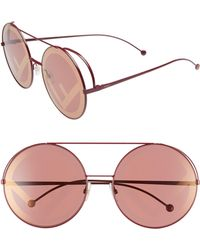 970dce4b919 Lyst - Fendi  run Way  Oversized Logo Metal Round Sunglasses in Pink
