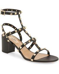 8e23f1e3ed7 Lyst - Valentino  rockstud Cutout  T-strap Sandal in Black