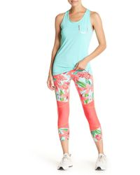 5c037f174c Body Glove - Winona Cobra Capri Leggings - Lyst