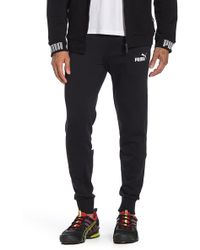 PUMA - Amplified Sweat Pants Tr (cotton Black) Casual Pants - Lyst