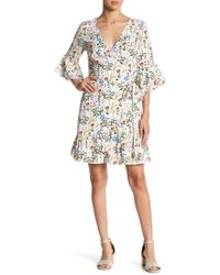 Lucy Paris - Floral Bell Sleeve Wrap Dress - Lyst