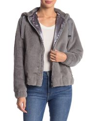 bdfa9a003c28 Lyst - French Connection Varsity Bomber W  Faux Fur Hood in Black