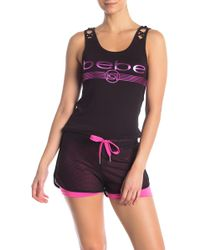 Bebe - Cage Front Logo Print Tank Top - Lyst