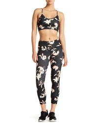 Threads For Thought - Half Lotus Cropped Leggings - Lyst
