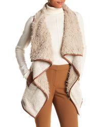 Angie - Faux Fur Lined Wool Blend Knit Vest - Lyst