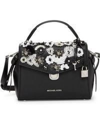 041b99b29 Calvin Klein Logan Saffiano Leather Floral Applique Satchel in White ...