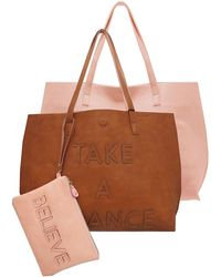 Under One Sky - Reversible Faux Leather Embossed Text Tote - Lyst